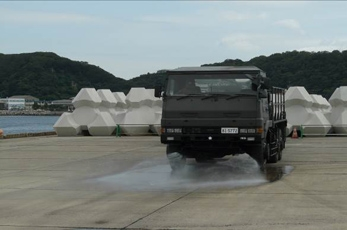 (Photo 13) Decontamination by JGSDF NBC Team