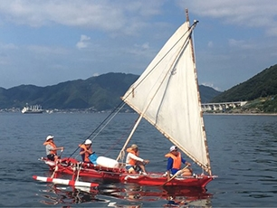(Photo 1) Friendship canoe sailing along an ancient route in Seto Inland Sea