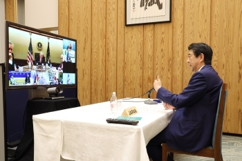 Photograph of the Prime Minister attending the video conference
